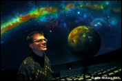 Dan Neafus, operations manager of Gates Planetarium at the Museum of Nature and Science in Denver, poses in front of a projection of Io, one of Jupiter's four largest moons. ÒJourney to the StarsÓ is the first new space education production in almost two years to show in the Gates Planetarium inside the Denver Museum of Nature and Science. The film was developed by the American Museum of Natural History in New York City, and as homage the opening scene takes place at sunset in Central Park.